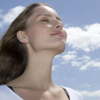 Young woman outdoors with eyes closed